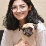 Woman holding a pug