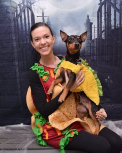 Dog and owner in a taco costume